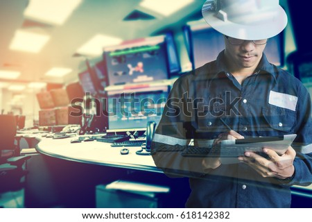 Double exposure of  Engineer or Technician man in working shirt  working with tablet in control room of oil and gas platform or plant industrial for monitor process, business and industry concept #618142382