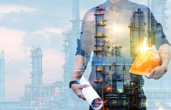Double exposure of Engineer with safety helmet  with oil refinery industry plant background