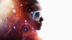 Double exposure of female face on white background. Abstract woman portrait. Digital art. Girl in glasses of virtual reality. Augmented reality, dream, future technology, game concept. Fire flares.