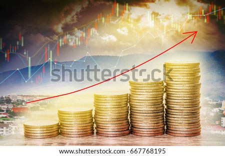 Double exposure of financial graph chart and rows of coins with red arrow indicates economic growing and blurred growth of the city background, concept of economy and finance.