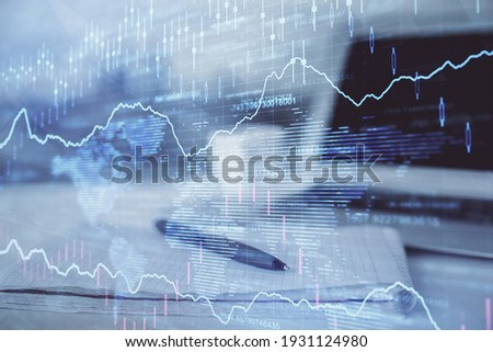 Double exposure of financial graph drawings and desk with open notebook background. Concept of forex market Foto stock ©