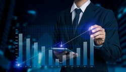 Double exposure of financial graph. Stock market chart. Businessman hand using tablet and stock market or forex graph, Forex investment business internet technology concept.