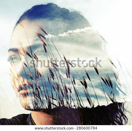 Double exposure of girl with gorgeous eyes and wheat field