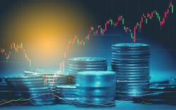 Double exposure of graph , stationary and rows of coins for goal office , finance and business concept background and forex trading graph with economy trends business or finance background.