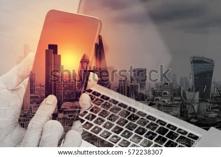 double exposure of hand using smart phone,laptop, online banking payment communication network technology 4.0,internet wireless application development sync app,London architecture city #572238307