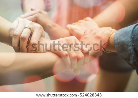 Double exposure of hands were a collaboration concept of teamwork and bokeh background