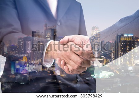 Double exposure of handshake and city  - Shutterstock ID 305798429
