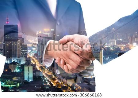 Double exposure of handshake and city  - Shutterstock ID 306860168