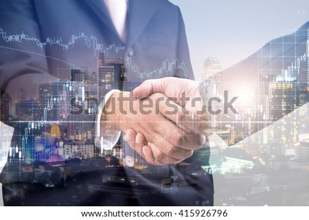 Double exposure of handshake and city with stock chart, investment concept.  - Shutterstock ID 415926796
