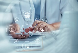 Double exposure of healthcare And Medicine concept. Doctor using smartphone with laptop and modern virtual screen interface.