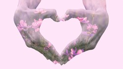 Double exposure of heart forming hands and flowers