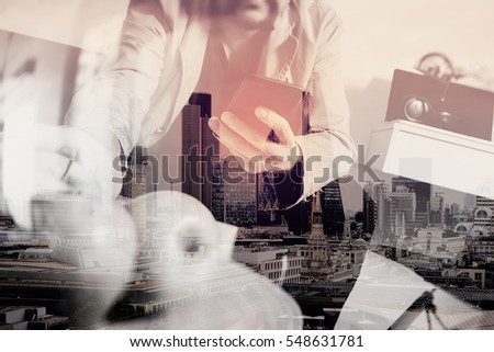 double exposure of hipster hand using smart phone for mobile payments online business,sitting on sofa in living room,holding green apple in wooden tray,London architecture city #548631781