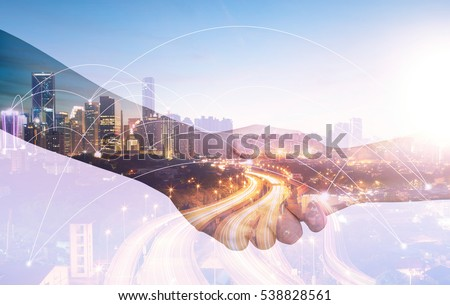 Double exposure of Image of businessmen hand shake, concept of network connection in urban life. #538828561