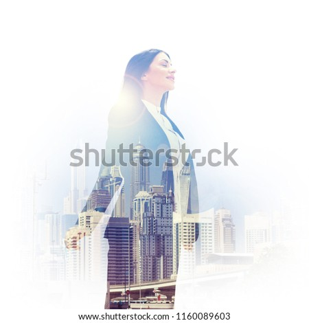 Double exposure of inspired woman in formals and cityscape of Dubai  #1160089603