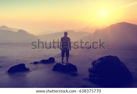 Double Exposure of Man, mountains and sea in the sunrise.Travel Lifestyle conceptual background