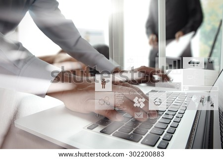 double exposure of new modern laptop computer with businessman hand working and business strategy as concept