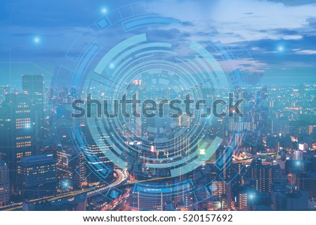Double exposure of night cityscape with technology graphic design
