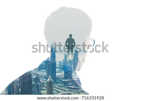 Double Exposure Of Person's Head With Eyeglasses And City