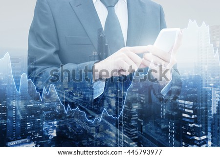 Double exposure of professional businessman connect internet smart phone and cityscape of business centre with international world financial graph, Business , finance , trading and banking concept
