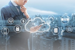 Double exposure of professional businessman connected Cloud technology with internet and wireless network with smart phone and city of business background in business trading and technology concept
