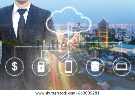 Double exposure of professional businessman connected Cloud technology with internet and wireless network with his smart phone and cityscape background in business trading and technology concept