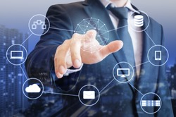Double exposure of professional businessman touch on screen connected devices with  digital technology internet and wireless network and city of business background in business and technology concept