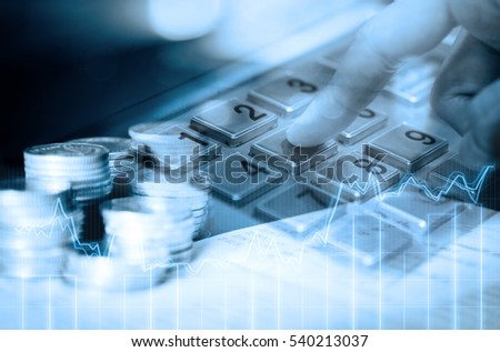 double exposure of row of coins on the book bank and the close up of people hand pressing ATM keypad in finance and banking concept