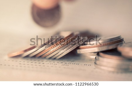 Double exposure of rows of coins in soft color for finance and business concept,Savings for tourism,Savings for investment,Savings for car purchases #1122966530