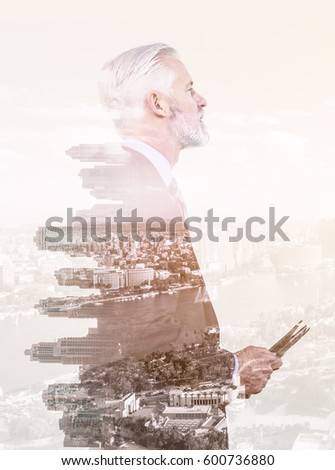 Double exposure of senior businessman in front of the big city #600736880