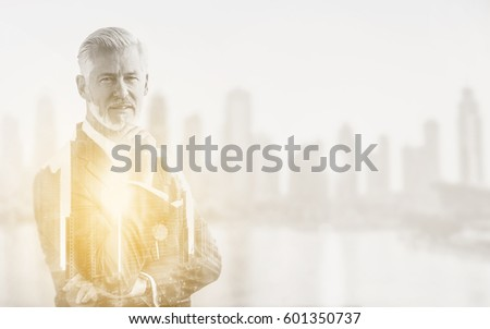 Double exposure of senior businessman in front of the big city #601350737