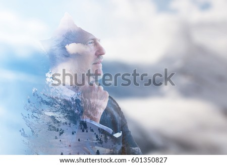Double exposure of senior businessman in front of the big  mountain #601350827