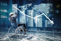 Double exposure of stressful disabled businessman sitting on wheelchair while looking at declining finance graph with world map background