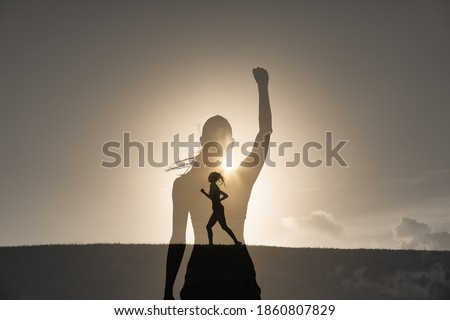 Double exposure of strong motivated woman running in the sunset. Never give up, inner strength and power concept.  Сток-фото ©