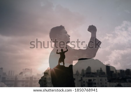 Double exposure of strong victorious, confident businessman in the city. Overcoming adversity, winning concept.  Stock photo ©