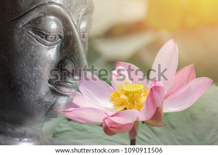 double exposure of the lotus flower or water lily and face of buddha  statue. Buddhism is popular in  china japanand thai people so many culture of Thailand involved buddha.