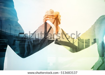Double exposure of two business persons shaking hands and bridge skyline, relationship conceptual abstract