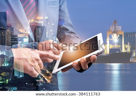 double exposure of two businessmen using tablet at meeting with city night and sea port background #384111763