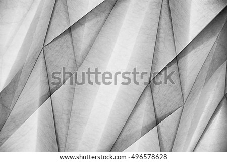 Double exposure of wall or ceiling relief structure with polygonal pattern. Abstract black and white background on the subject of modern architecture, interior and finishing materials.