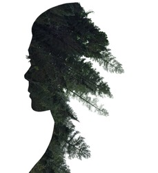 Double exposure of woman in profile and forest.
