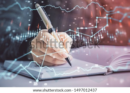 Double exposure of woman's hands making notes with forex graph hologram. Concept technical analysis. #1497012437