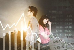 Double exposure of young business couple looks stressed while standing with declining stock market chart on world exchange rate background