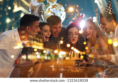 Double exposure of young people at Birthday party and illuminated city at night