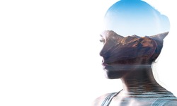 Double exposure of young woman and sunset background