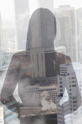 Double exposure of young woman over cityscape