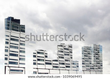 Double exposure photo of business cityscape with skyscrapers. Realistic though unreal sample of modern architecture or urban environment.