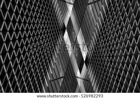 Double exposure photo of louvered wall. Realistic though unreal industrial or office interior in hi-tech / minimalism style. Abstract black and white image on the subject of modern architecture.