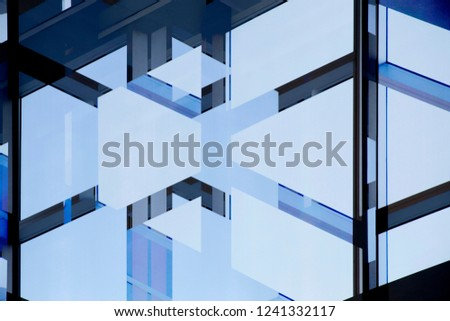 Double exposure photo of office building fragment against clear blue sky. Glass wall with metal framework. Abstract modern architecture background. Structural glazing. #1241332117
