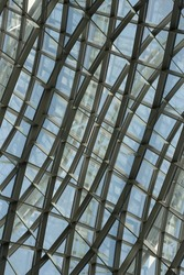 Double exposure photo of structural glazing. Abstract modern architecture. Hi-tech building fragments with framed glass arch structure.