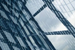 Double exposure photo of structural glazing. Windows of hi-tech building. Abstract modern architecture. Geometric background of frames. Polygonal pattern of transparent panels in diagonal perspective.