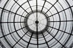 Double exposure photo of transparent circular glass ceiling / roof at two different zooms. Realistic but not real architectural image with doubled number of circles compared to the real object.